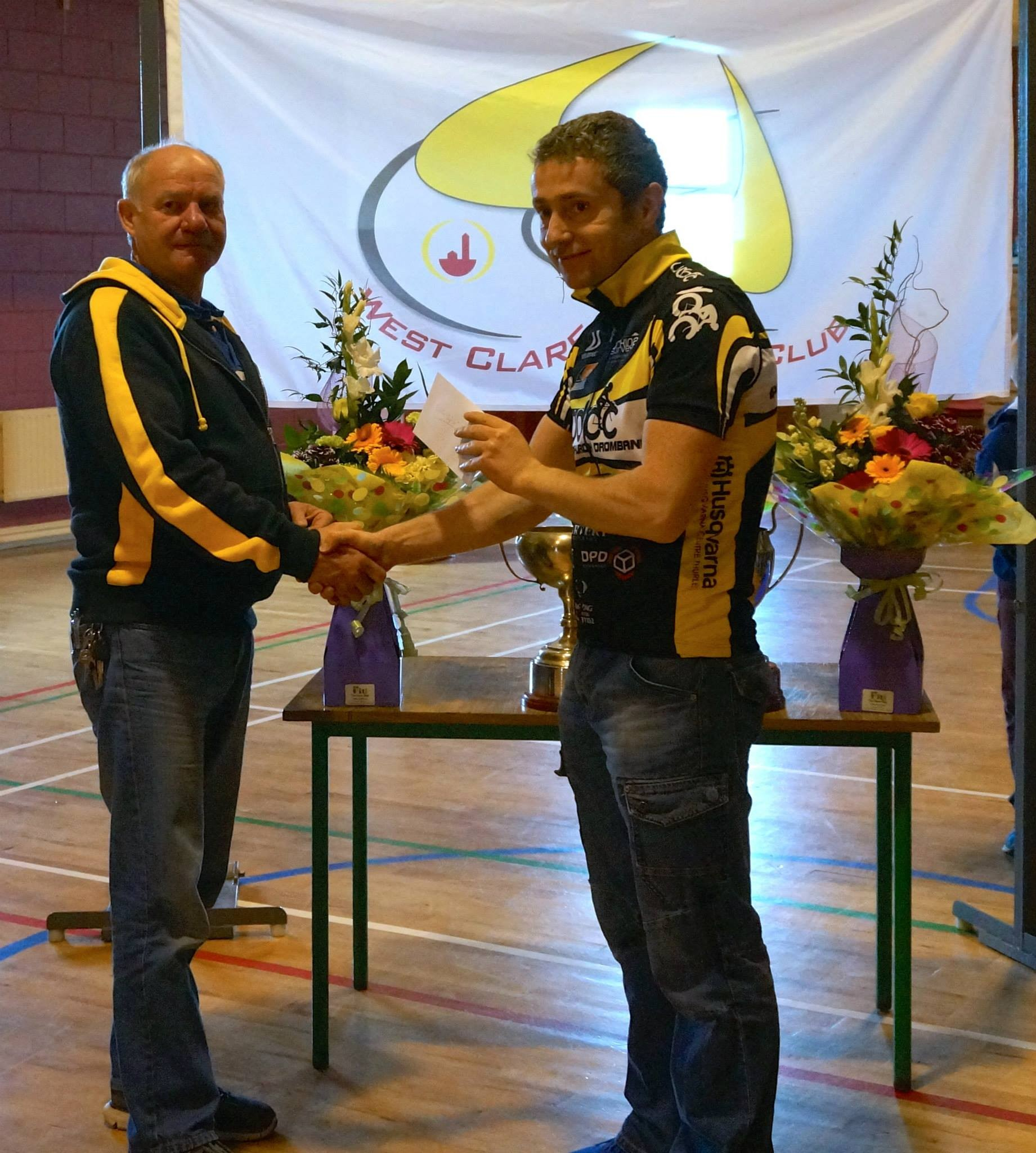 Ken Costello is presented with 4th place prize
