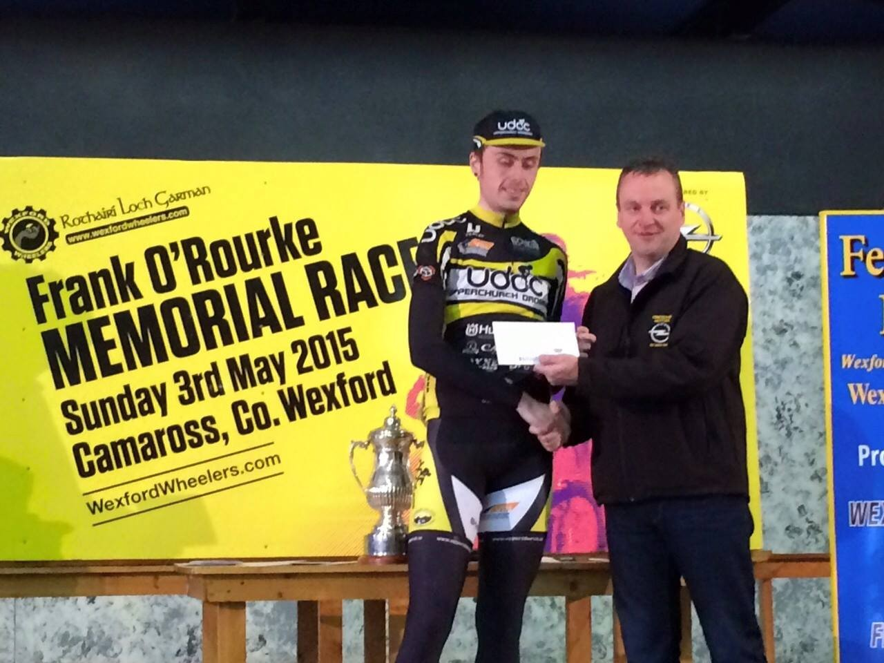 Peter Leahy is presented with his prize for 2nd place in the A4 Race